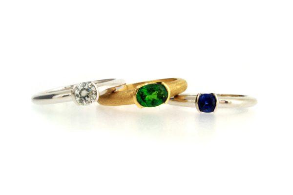 Brilliant Cut Diamond, Oval Tsavorite & Cushion Sapphire Platinum & 18ct Gold Rings by Robert Feather Jewellery