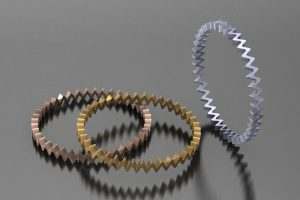 Offset Bangle Design in 18ct Red & Yellow Gold & Platinum by Robert Feather Jewellery