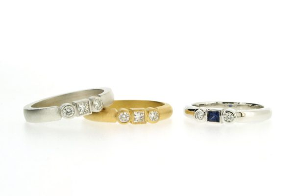 Sapphire & Diamond Three Stone Princess Cut & Round Brilliant Cut 18ct Gold Rings by Robert Feather Jewellery