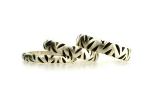 Notch Patterned Oxidised Silver Rings by Robert Feather Jewellery