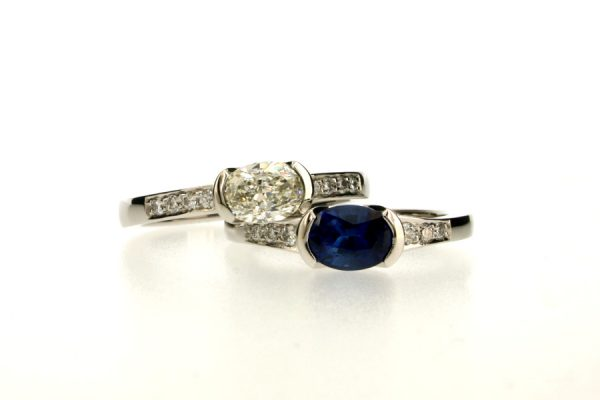 Oval Diamond & Sapphire Platinum Engagement Rings with Diamond Set Shoulders by Robert Feather Jewellery