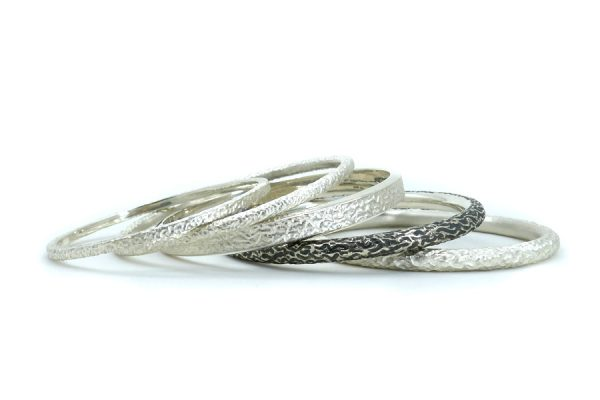 Burr Textured Silver Bangles by Robert Feather Jewellery